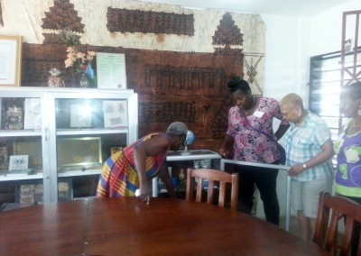 Mercy Amba Oduyoye gives tour of Talitha Qumi offices to three consultation participants