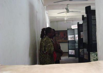 Participants view museum  exhibit at El Mina Castle